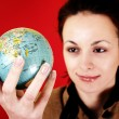 Globe in a girl's hands — Stock Photo #9208687