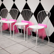 Row of White Chairs with Pink Ribbons — Stock Photo