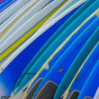 Stock Photo: Row of Brightly Colored Surf Boards