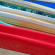 Stock Photo: Row of Brightly Colored Surfboards