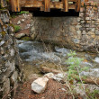 Royalty-Free Stock Photo: Wooden Bridge Between Stone Walls and Stream