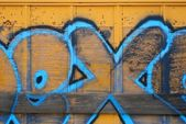 Yellow Boxcar With Blue Spraypaint — Stock Photo