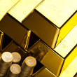 Gold bars and coins — Stock Photo #10267394