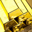 Gold bars and coins  — Stock Photo