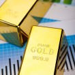 Gold Ingot on a Chart — Stock Photo