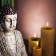 Buddha with candle - Stock Photo