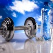 Fitness, dumbell and blue sky - Stock Photo