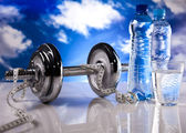 Fitness, dumbell and blue sky — Photo