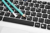 Pencils on a keyboard — Fotografia Stock