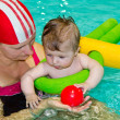 Family with baby  in the swimming pool — Stock Photo
