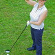 An image of a young female golf player - Stock Photo