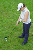 An image of a young female golf player — Stock Photo