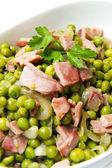 Peas with ham — Stock Photo
