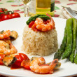Risotto with shrimp, mussels and asparagus — Stock Photo #8367944