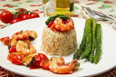 Risotto with shrimp, mussels and asparagus — Stock Photo
