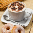 Cappuccino with donuts and strudel — Stock Photo