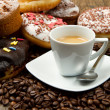 Stock Photo: Doughnut with an espresso