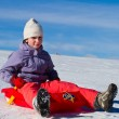 A girl sliding in the snow — Stock Photo