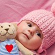Little girl with her teddy bear — Stock Photo #8758468