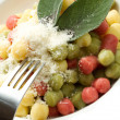 Tricolour gnocchi with sage - Stock Photo
