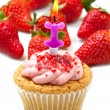 Strawberry cupcake with candle — Stock Photo