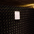Stock Photo: Stacked up wine bottles in the cellar