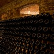 Stacked up wine bottles in cellar — Stock Photo #9633302