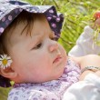 Baby playing with blade of grass — Stock Photo #9700574