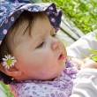 Baby playing with blade of grass — Stock Photo #9700594