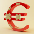 Euro sign with bandage — Stock Photo