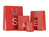 Red shoping bags and SALE text — Stock Photo
