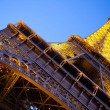Eiffel Tower from the bottom at the dusk. Paris, France — Stock Photo