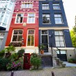 Colorful houses in Amsterdam - Stock Photo