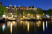 Colorful houses in Amsterdam at night — Stock Photo