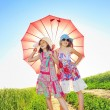 Stock Photo: Two girls under umbrella