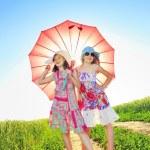 Two girls under umbrella — Stock Photo