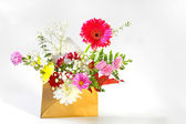 Flowers in envelope — Stock Photo
