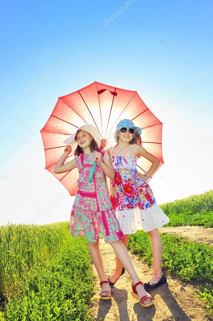 Two girls under umbrella — Stock Photo #10132400