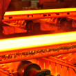 Hot steel on conveyor — Stock Photo #8472344
