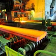 Hot steel on conveyor — Stock Photo #8472349