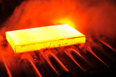 Hot steel on conveyor — Stock Photo
