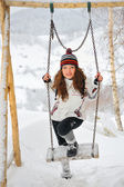 Young Beautiful Woman in winter time and swing — Foto de Stock