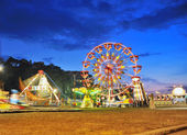 Ferris wheel in a summer night — Stock Photo