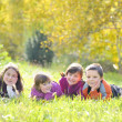 A group of children laying down in the grass — Stock Photo #9015068