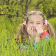 Stock Photo: Young girl lays in field