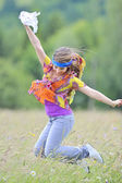 Jumping girl against summer meadow — Stok fotoğraf