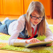 Girl holding a touchpad tablet — Stock Photo #9728681
