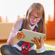 Girl holding a touchpad tablet — Stock Photo
