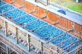 Hot ore on conveyor — Stock Photo