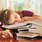 Teenager girl sleeping on books — Stock Photo